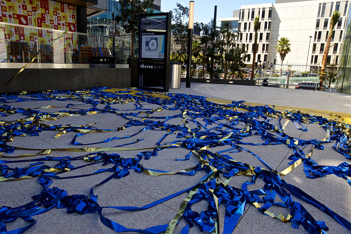 "Blue and gold streamers litter ""Thrive City"" plaza following a musical performance to celebrate the opening of Chase Center arena on Tuesday, Sept. 3, 2019. (Kevin N. Hume/S.F. Examiner)"