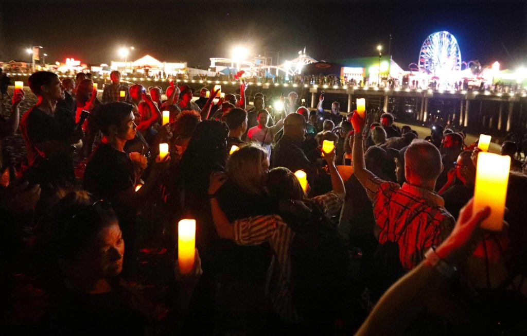 SANTA MONICA, CA - SEPTEMBER 5, 2019 - - Some of the thousands of people join a vigil on the beach in honor of those who lost their lives in the Conception boat fire along the Santa Monica Pier in Santa Monica on September 5, 2019. The ceremony was organized by organized by Heal The Bay and Eco Dive Center. (Genaro Molina / Los Angeles Times/TNS)