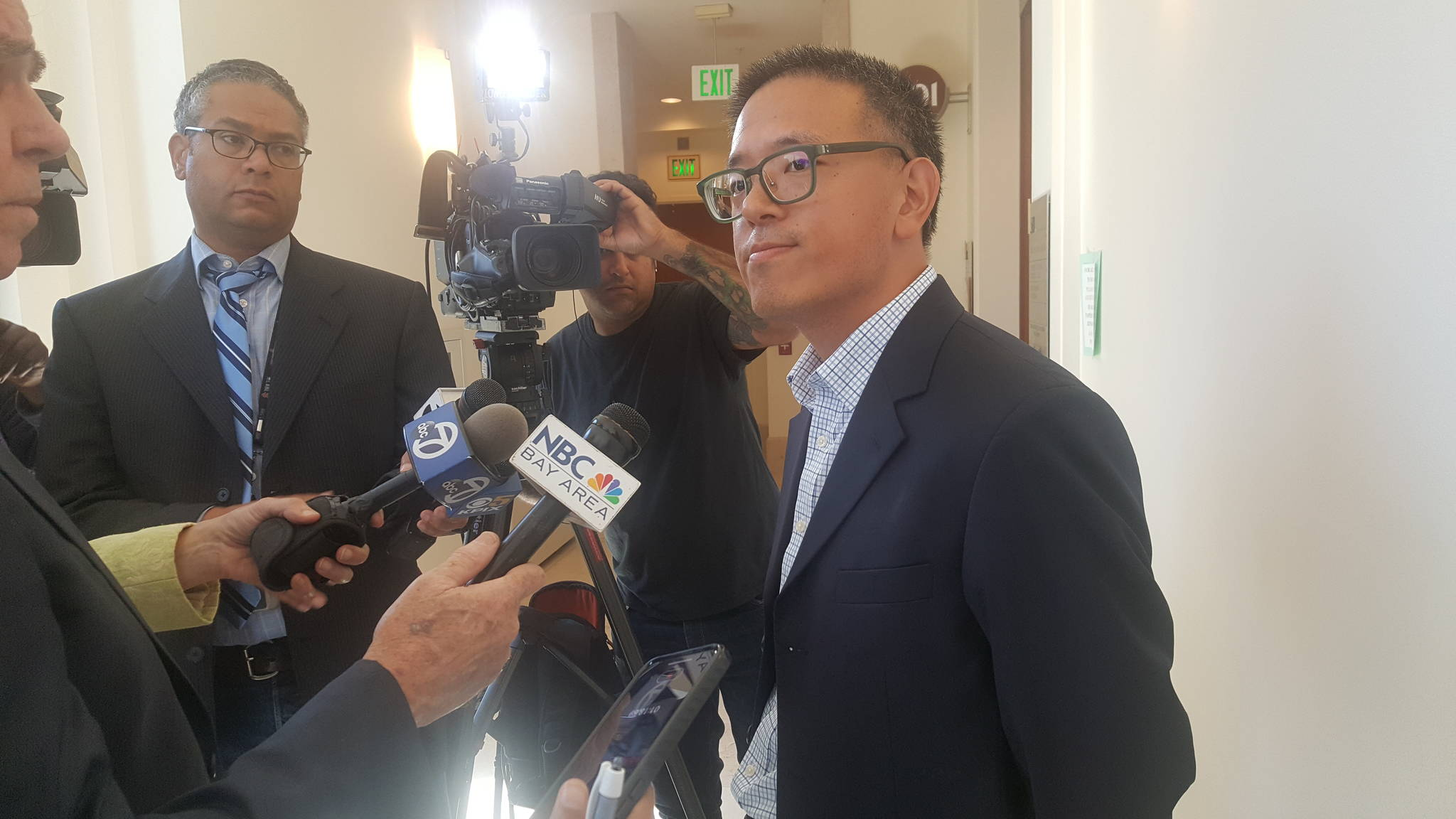 South Beach resident Wallace Lee, a member of Safe Embarcadero for All, discusses with media why he opposes the waterfront Navigation Center. (Joshua Sabatini/S.F. Examiner)