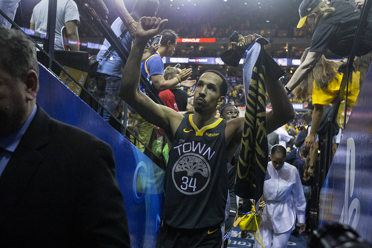 Golden State Warriors forward Shaun Livingston slaps hands with fans after the Warriors were defeated by the Toronto Raptors in Game 6 of the NBA Finals at Oracle Arena in Oakland, Calif. on Thursday, June 13, 2019. (Kevin N. Hume/S.F. Examiner)