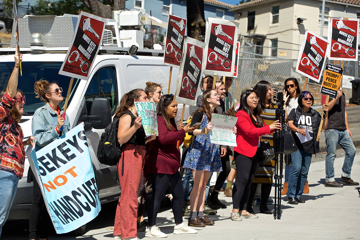 Protesters attempt to get the attention of U.S. Housing and Urban Development Secretary Ben Carson as he leaves following a visit with residents in the Potrero Terrace and Potrero Annex on Connecticut Street on Tuesday, Sept. 17, 2019. (Kevin N. Hume/S.F. Examiner)