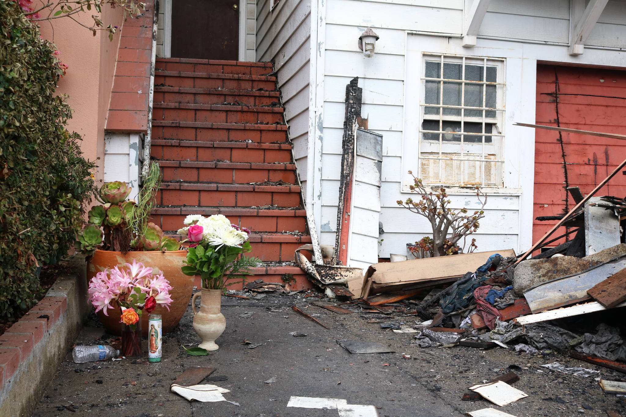 Flowers and remembrances collected at the home Wednesday morning. (Cody McFarland/Special to the S.F. Examiner)