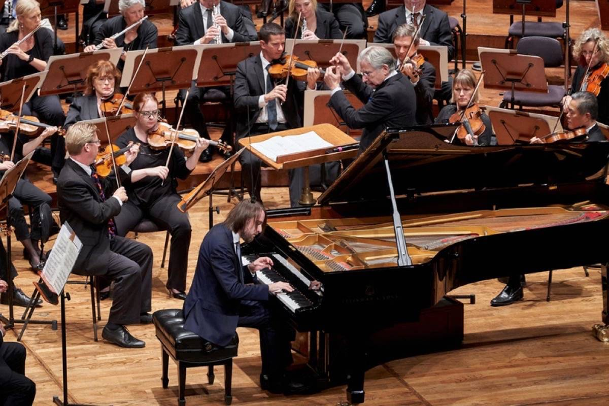 "Michael Tilson Thomas conducted the San Francisco Symphony on Thursday in the premiere of John Adams' ""I Still Dance,"" Schumann's Symphony No. 3 and Rachmaninoff's Piano Concerto No. 4 performed by Daniil Trifonov. (Courtesy Grittani Creative LTD)"