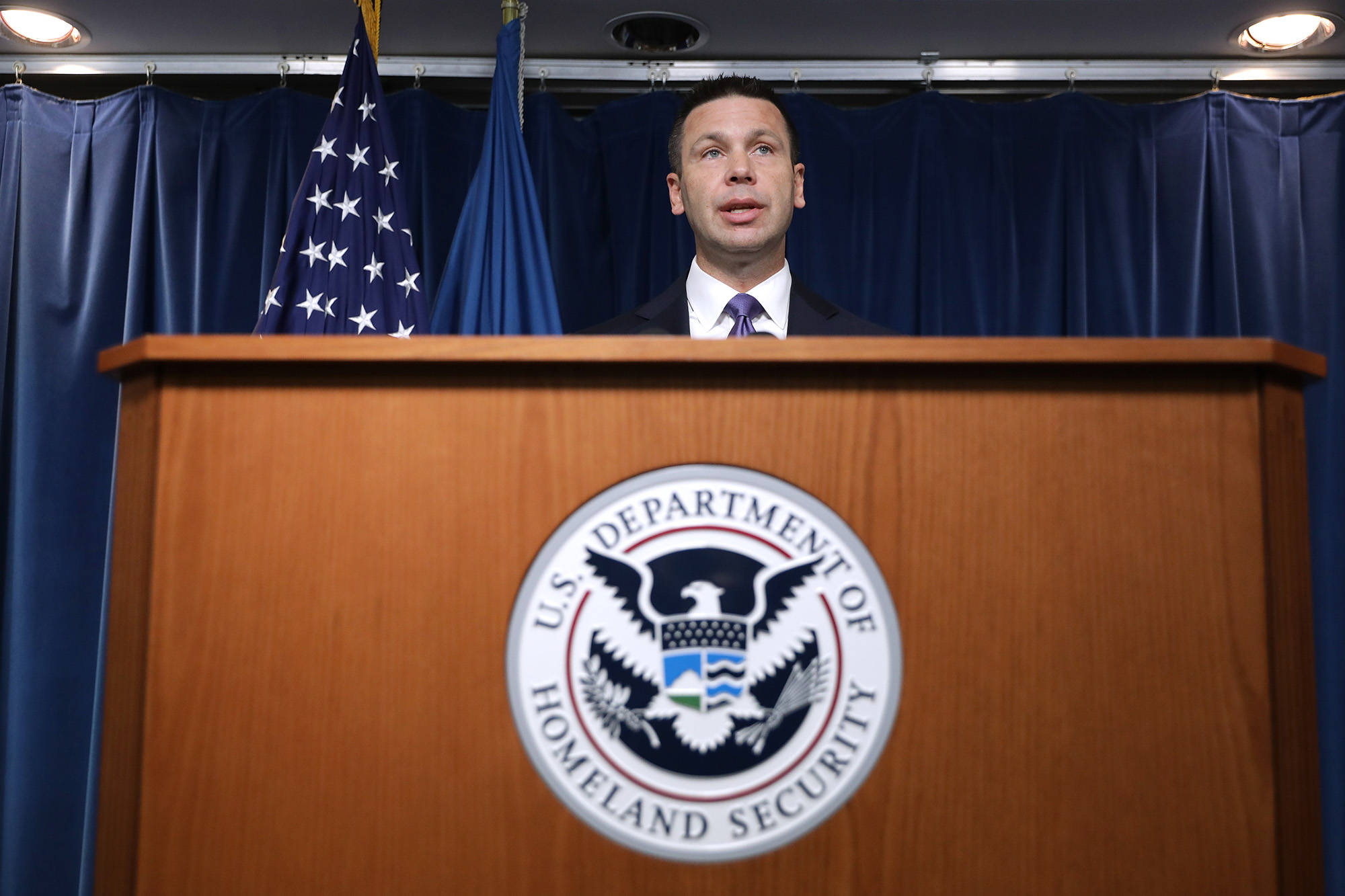 Department of Homeland Security acting Secretary Kevin McAleenan holds a news conference at the Ronald Reagan Building on August 21, 2019, in Washington, D.C. (Chip Somodevilla/Getty Images/TNS)