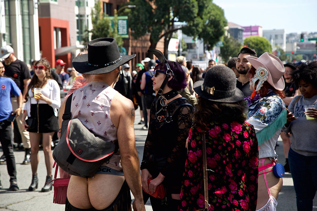 People hang out near the main stage at the 36th annual Folsom Street Fair on Sunday, Sept. 29, 2019. (Kevin N. Hume/S.F. Examiner)