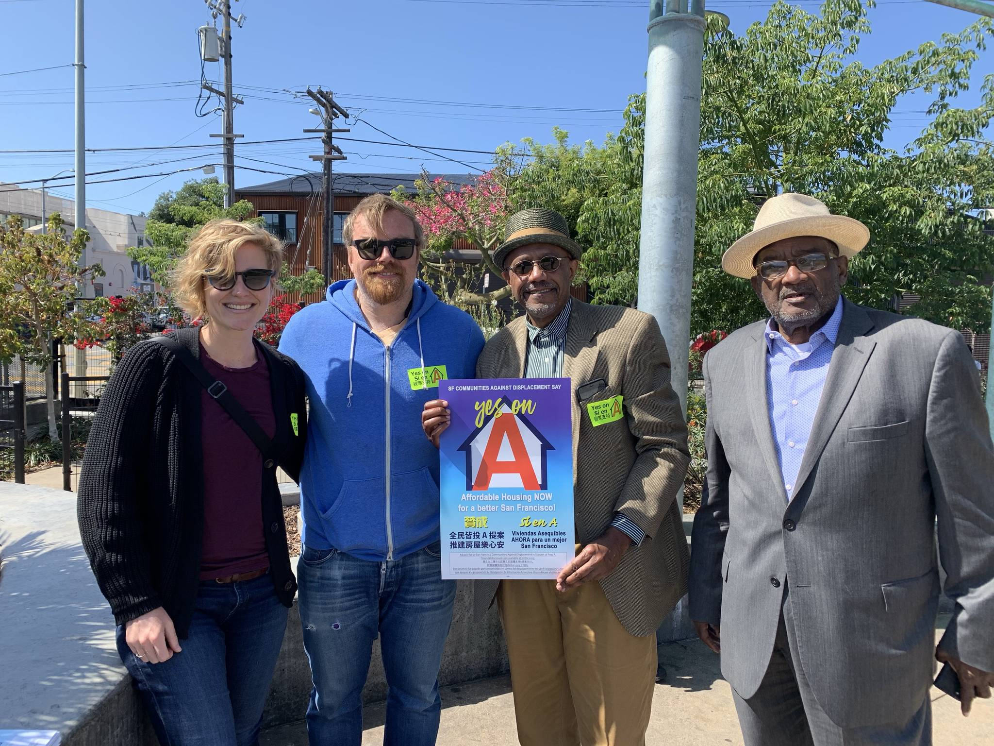 From left: Alexandra Goldman, a community planner at Tenderloin Neighborhood Development Corporation; Matthias Mormino, a policy analyst at Chinatown Community Development Center; Alan Glenn, executive director at Without Walls Church and Rev. Arnold Townsend, a board member at Without Walls Church, gathered at Chan Kaajal Park in the Mission District on Saturday, Sept. 28 2019, to promote Proposition A, an affordable housing bond measure. (Caroline Ghisolfi/Special to the S.F. Examiner)