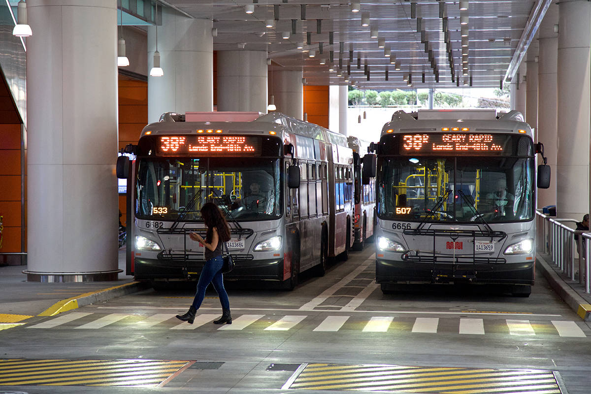 A woman walks past the Muni bus area along Fremont Street at Salesforce Transit Center on Tuesday, Oct. 8, 2019. (Kevin N. Hume/S.F. Examiner)