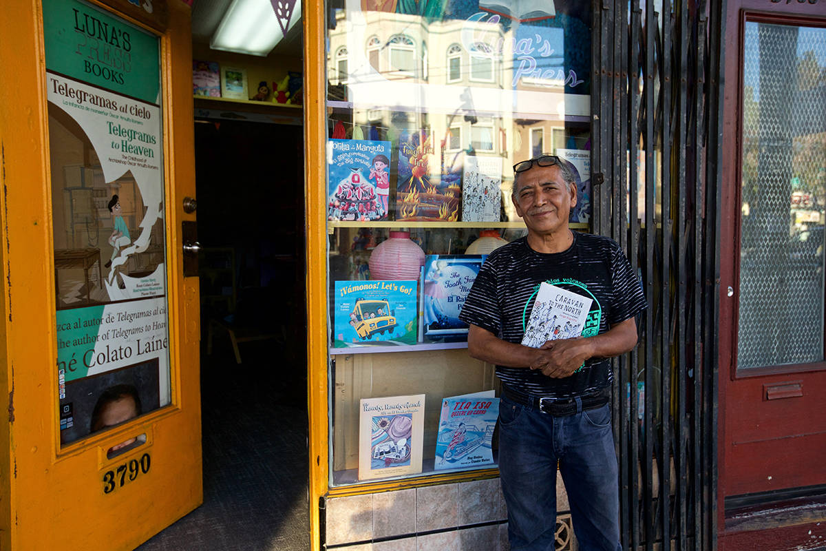 Author Jorge Argueta in front of his bookstore, Luna's Press & Bookstore on Mission Street in Bernal Heights. (Kevin N. Hume/S.F. Examiner)