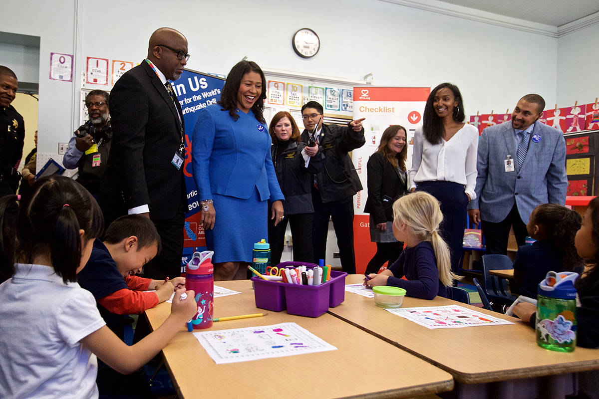 Mayor London Breed and Superintendent Vincent Matthews greet students in Tihoot Terrefe's kindergarten class as they take part in the Great California ShakeOut at Rosa Parks Elementary School on Thursday, Oct. 17, 2019, the 30th anniversary of the Loma Prieta earthquake. (Kevin N. Hume/S.F. Examiner)