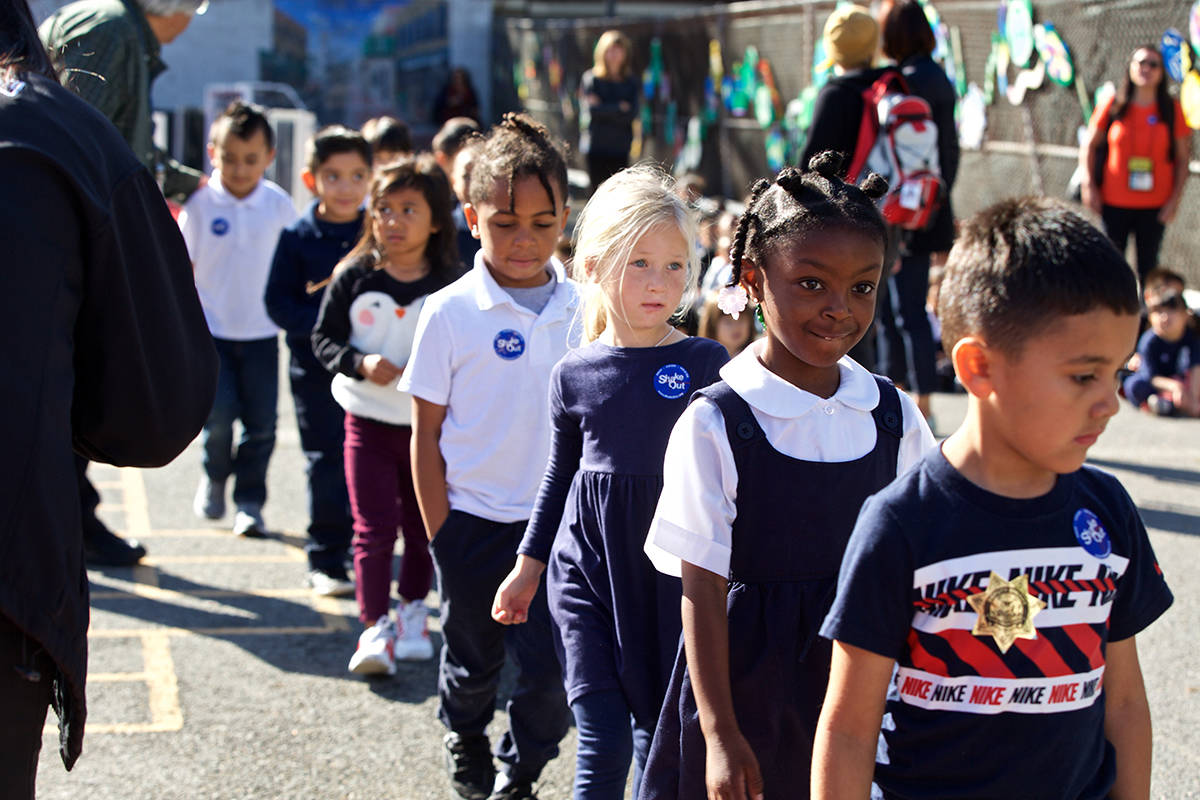 Students in Tihoot Terrefe's kindergarten class line up on the playground after taking part in the Great California ShakeOut at Rosa Parks Elementary School on Thursday, Oct. 17, 2019. (Kevin N. Hume/S.F. Examiner)