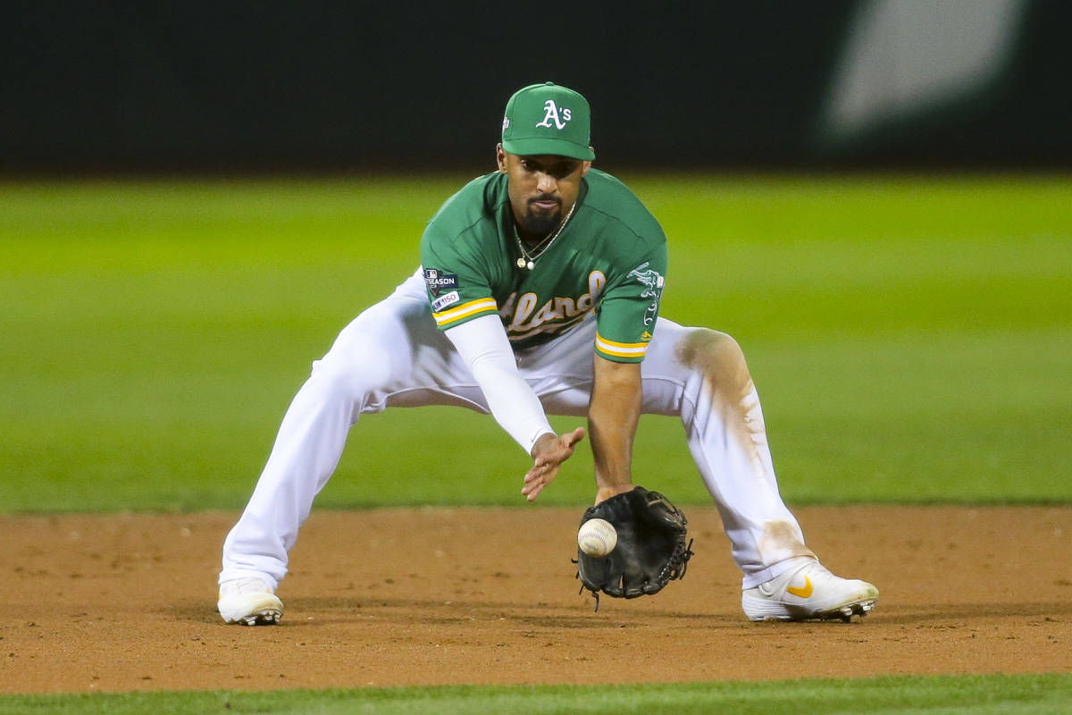 Oakland Athletics short stop Marcus Semien (10) fields a ground ball in the 8th inning against the Tampa Bay Rays at the Oakland Coliseum on Oct. 2, 2019 in Oakland, California. (Chris Victorio | Special to S.F. Examiner).