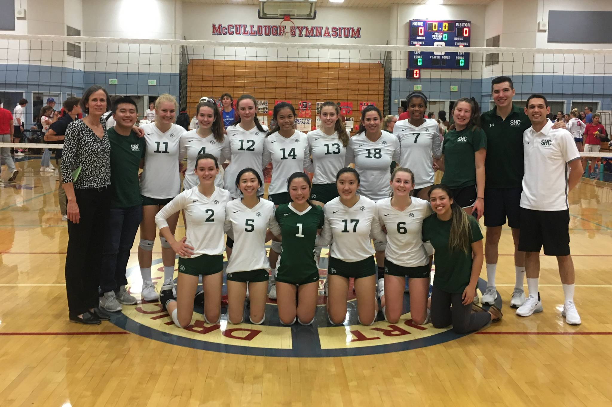 The Sacred Heart Cathedral girls' volleyball team celebrates its second straight West Catholic Athletic League title at St. Ignatius's McCullough Gymnasium in San Francisco on Oct. 24, 2019. (Courtesy / Sacred Heart Cathedral Athletics)
