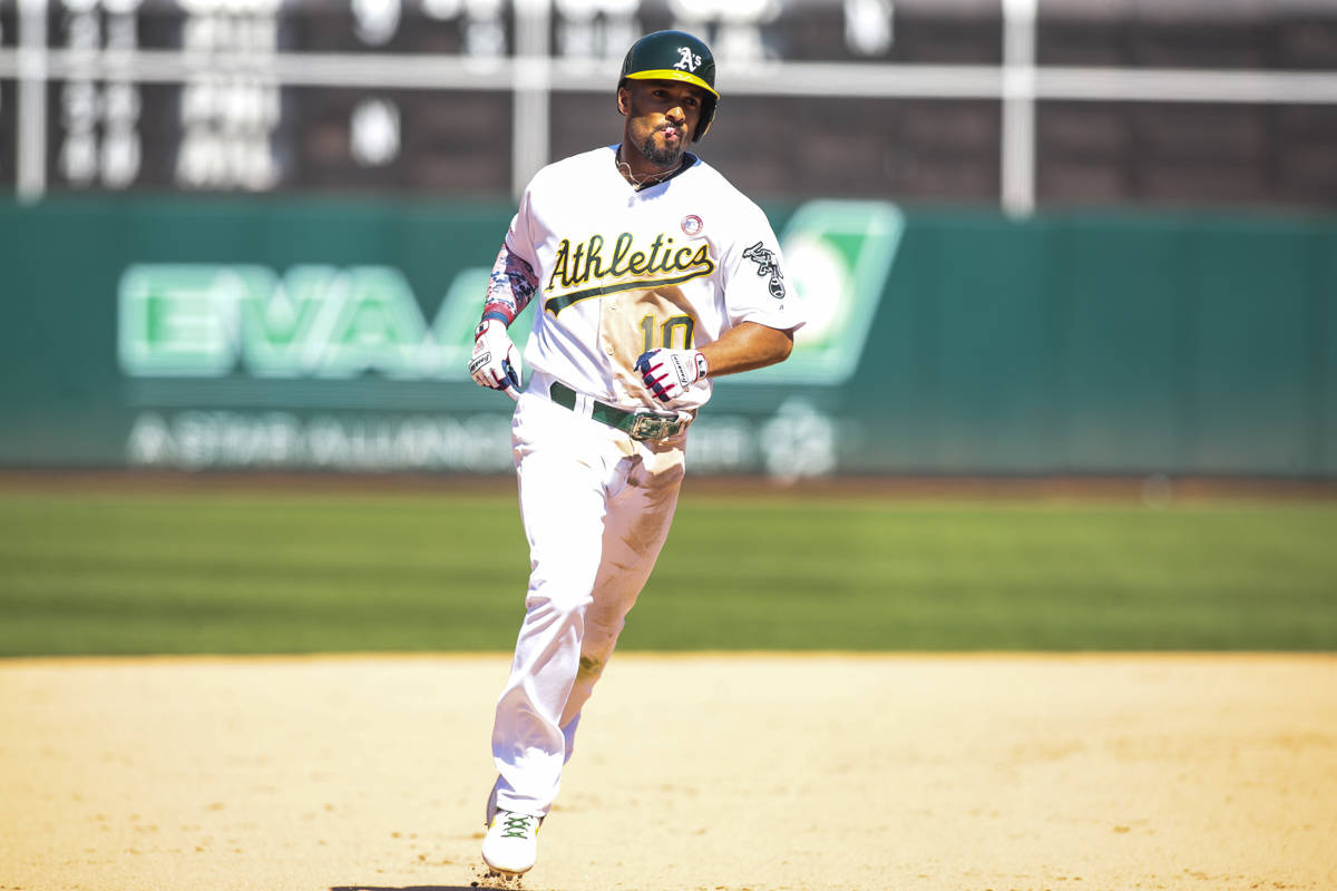 Oakland Athletics shortstop Marcus Semien (10) rounds third base after hitting a grand slam in the 8th inning against the Minnesota Twins to extend their lead to 7-3 at the Oakland Coliseum on July 4, 2019 in Oakland, Calif. (Chris Victorio | Special to S.F. Examiner)