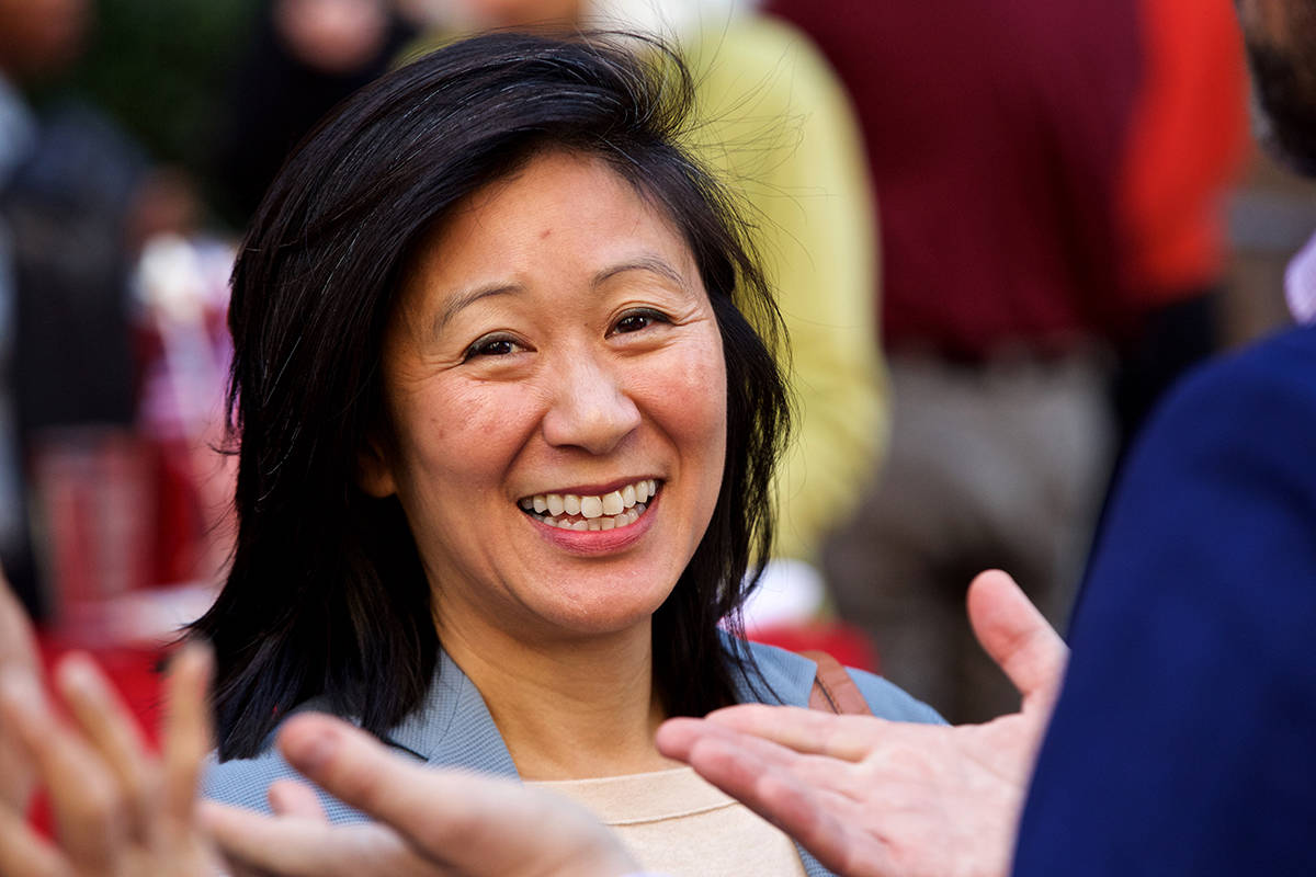 CCSF Board member Ivy Lee, who was appointed by Mayor London Breed, smiles while chatting with host Alex Clemens at the traditional Election Day luncheon at John's Grill on Tuesday, Nov. 5, 2019. Lee is running unopposed. (Kevin N. Hume/S.F. Examiner)