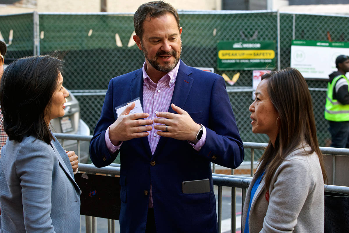 Host Alex Clemens chats with CCSF Board candidate Ivy Lee, left, and SF School Board candidate Jenny Lam at the traditional Election Day luncheon at John's Grill on Tuesday, Nov. 5, 2019. (Kevin N. Hume/S.F. Examiner)