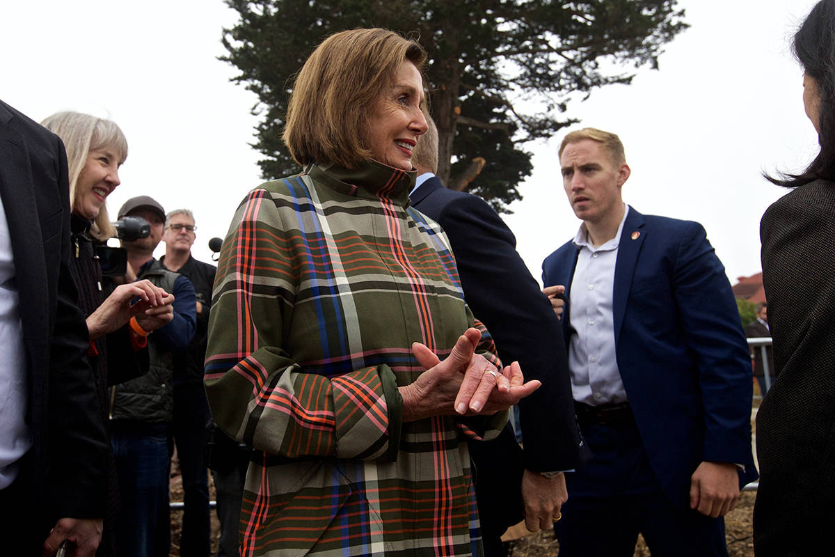 "Speaker Nancy Pelosi smiles while watching others toss buckets of dirt at a ""ground making"" ceremony for the future Presidio Tunnel Tops park on Thursday, Nov. 7, 2019. (Kevin N. Hume/S.F. Examiner)"
