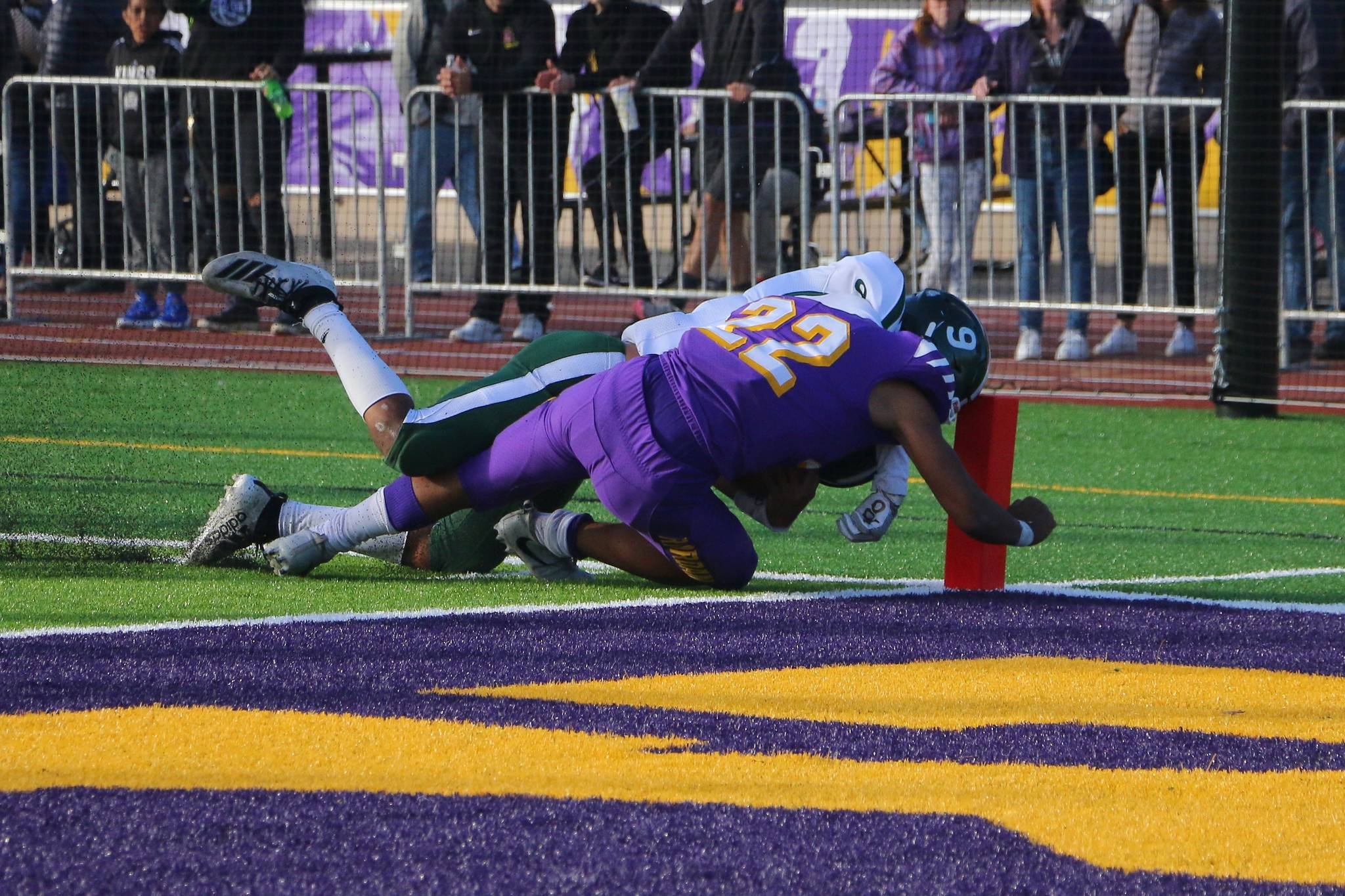 Archbishop Riordan running back Lavaka Kefu scores his third touchdown in the fourth quarter of the Crusaders' 44-7 win over Sacred Heart Cathedral at Mayer Family Field in San Francisco on Nov. 9, 2019. (Ryan Gorcey / S.F. Examiner)