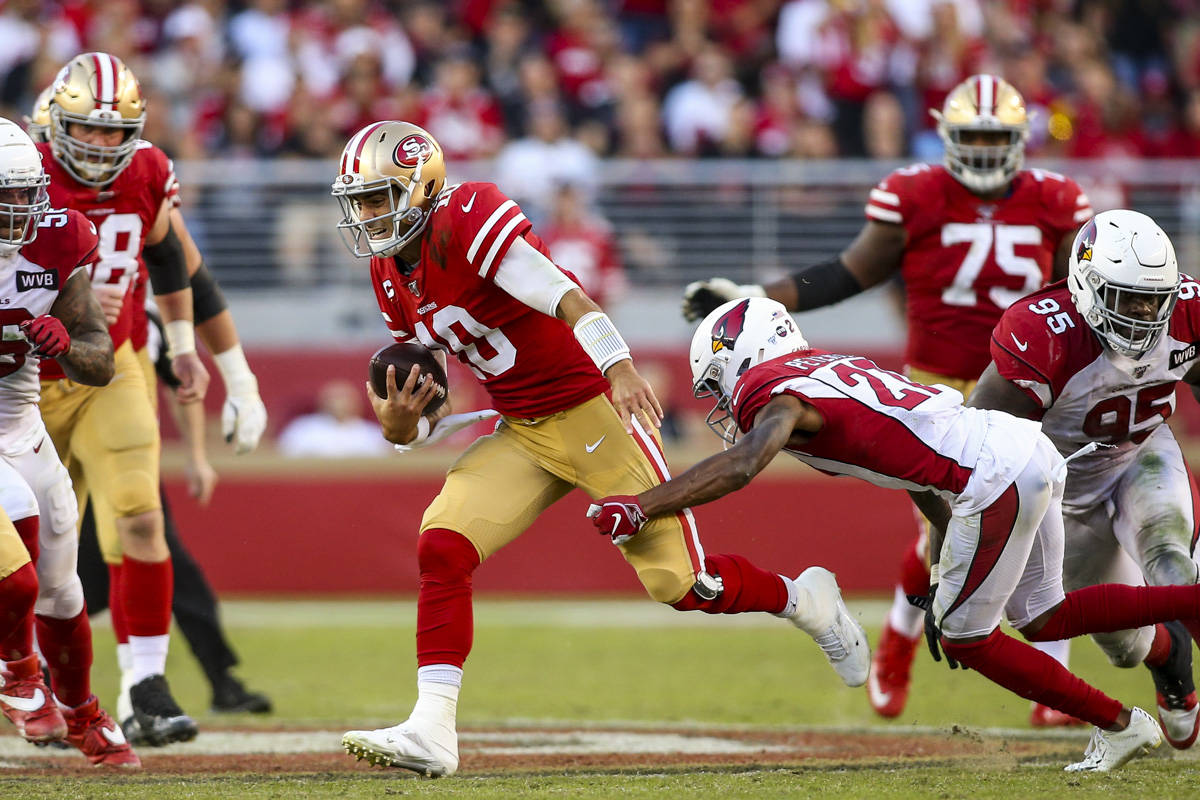 San Francisco 49ers quarterback Jimmy Garoppolo (10) scrambles out of the pocket before being tackled by Arizona Cardinals cornerback Patrick Peterson (21) in the fourth quarter at Levi's Stadium on November 17, 2019 in Santa Clara, California. (Chris Victorio | Special to the S.F. Examiner)