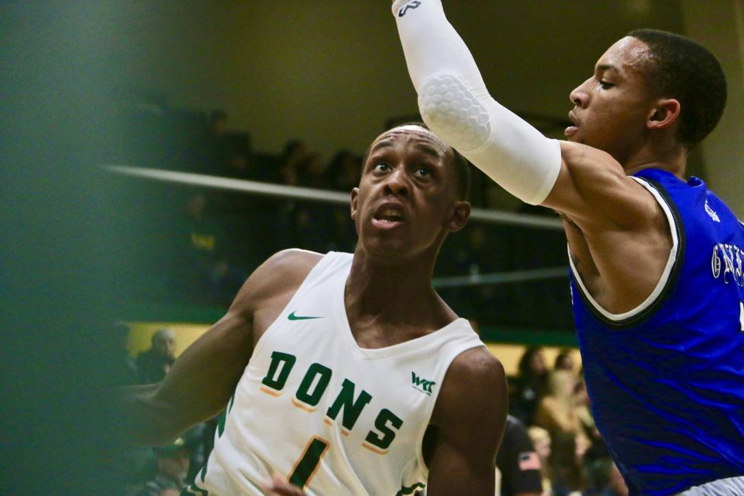 University of San Francisco guard Jamaree Bouyea (1) drives against Hampton's Deondre Griffin (11) during the first half of the Dons' game against the Pirates at War Memorial Gym in San Francisco on Nov. 26, 2019. (Ryan Gorcey / S.F. Examiner)