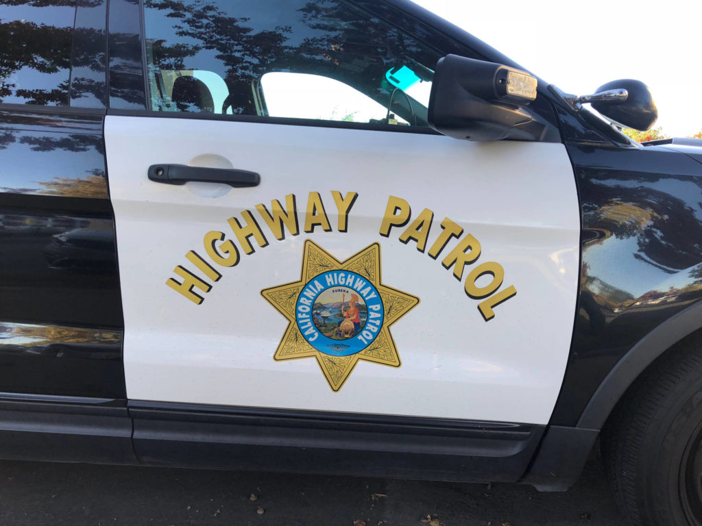 Closeup of CHP - California Highway Patrol car sign and emblem on door of a Ford SUV. (Courtesy image)