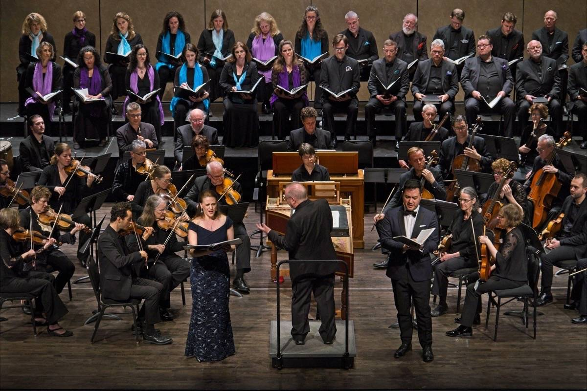 "At center, from left, Robin Johannsen, Nicholas McGegan and Nicholas Phan perform in Philharmonia Baroque Orchestra and Chorale's ""Judas Maccabaeus."" (Courtesy Frank Wing)"