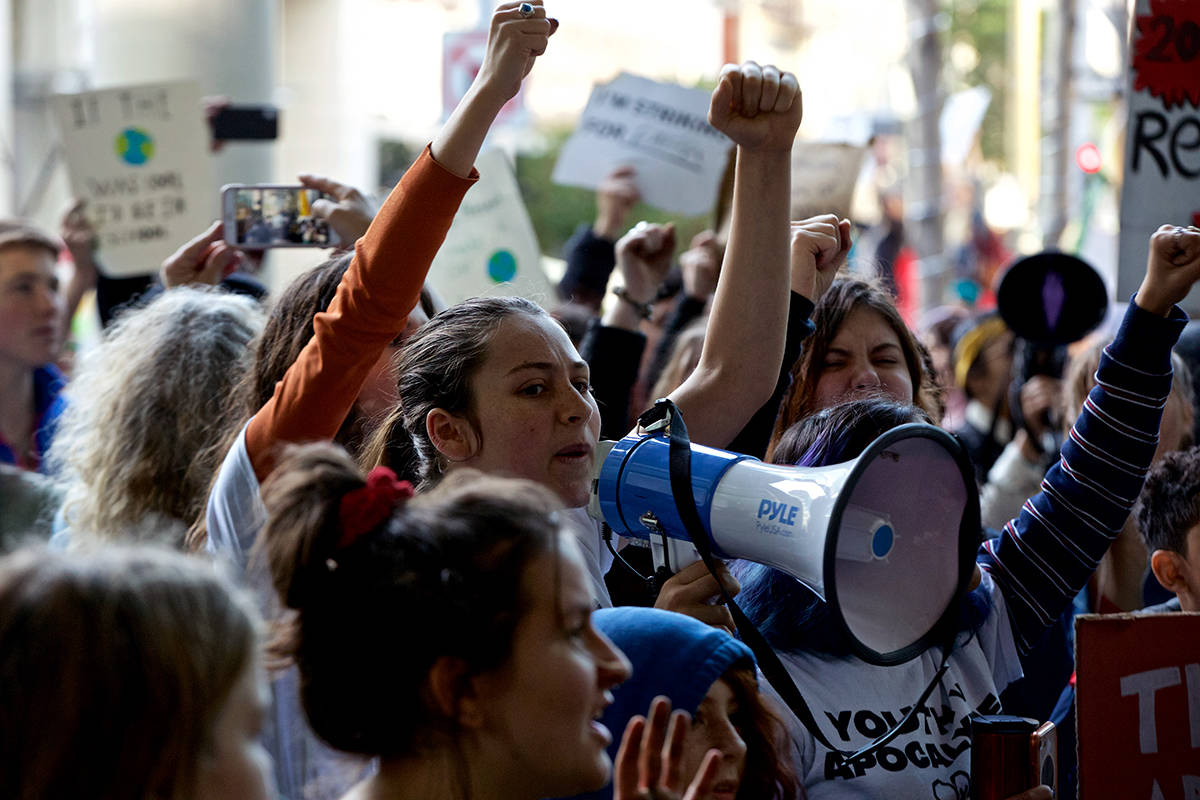 Young climate protesters chant during a demonstration outside the SF headquarters of BlackRock, an investment management corporation, to urge the corporation to divest its funds from fossil fuel companies on Friday, Dec. 6, 2019. (Kevin N. Hume/S.F. Examiner)
