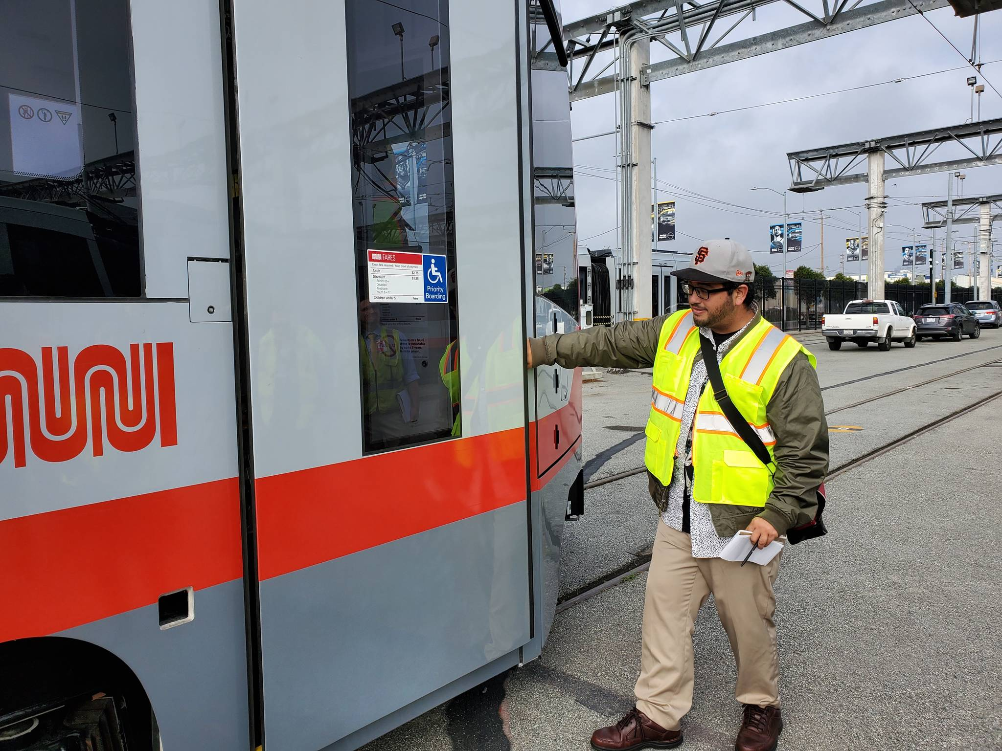 Examiner reporter Joe Fitzgerald Rodriguez tests repairs to doors on new Muni light-rail trains. The doors previously closed on passengers hands, causing some injuries.