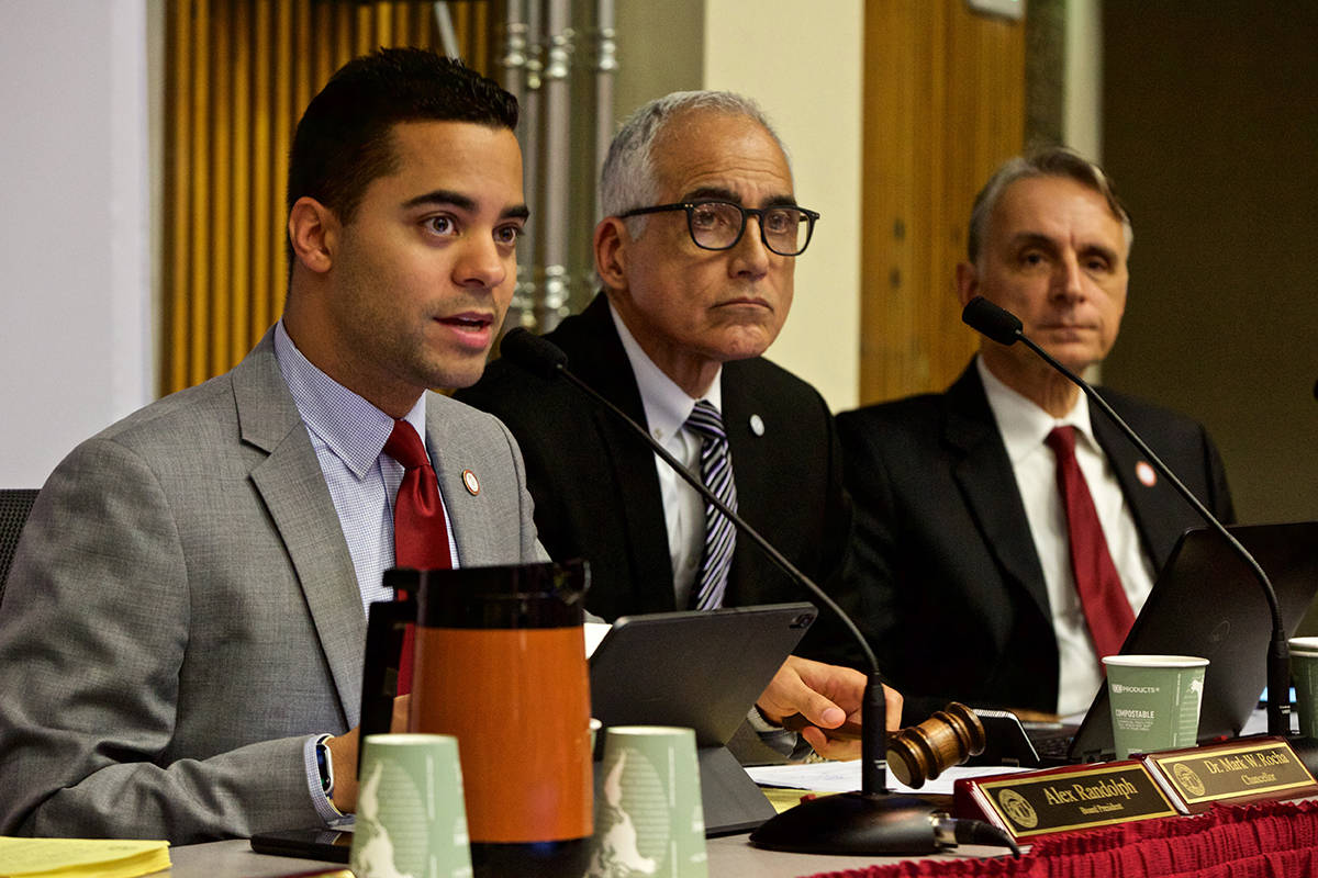Alex Randolph, left, president of the City College of San Francisco Board of Trustees, and CCSF Chancellor Mark Rocha listen to public comment regarding cuts to classes, particularly those for older adults, during a meeting of the CCSF Board of Trustees on Thursday, Dec. 12, 2019. (Kevin N. Hume/S.F. Examiner)