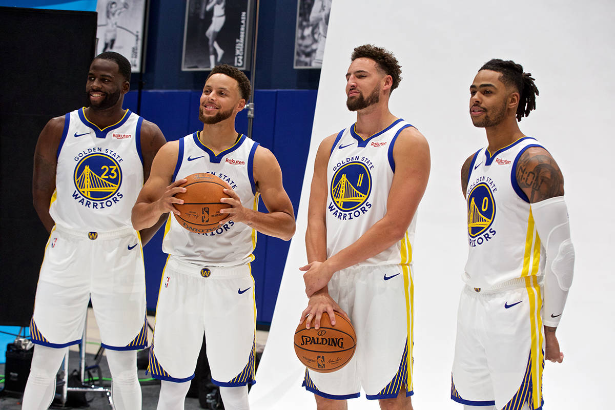 From left: Golden State Warriors forward Draymond Green and guards Stephen Curry, Klay Thompson and D'Angelo Russell pose for a group photo during media day at Chase Center on Monday, Sept. 30, 2019. (Kevin N. Hume/S.F. Examiner)
