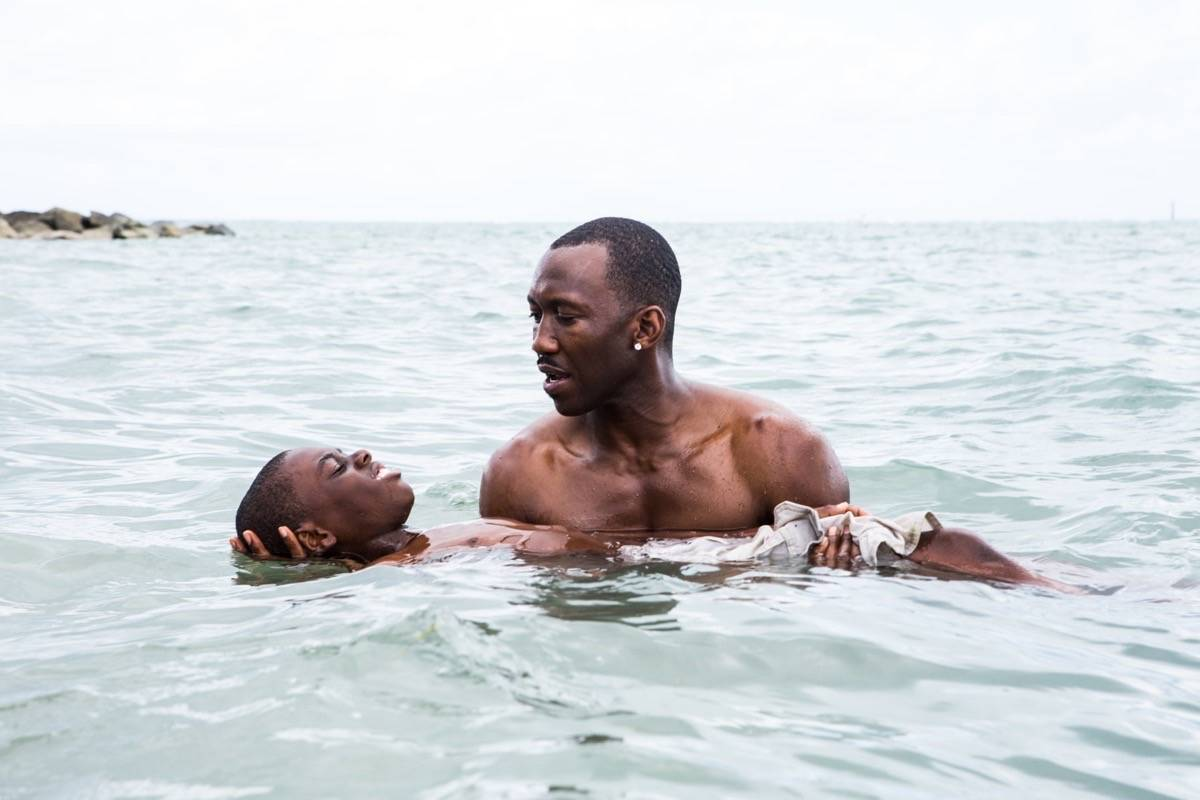"Alex Hibbert, left, and Mahershala Ali appear in Barry Jenkins' ""Moonlight,"" named among the 10 best movies from 2010-19. (Courtesy A24)"