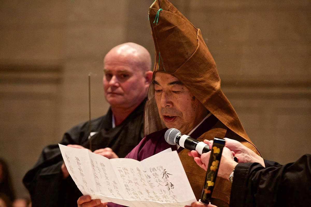 Rev. Gengo Akiba reads a verse as part of a Buddhist purification ritual at the Asian Art Museum's 34th annual Japanese New Year Bell-Ringing Ceremony on Tuesday, Dec. 31, 2019. (Kevin N. Hume/S.F. Examiner)