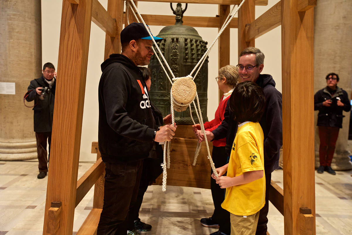 A group of museum patrons smile after ringing the Joya bell at the Asian Art Museum's 34th annual Japanese New Year Bell-Ringing Ceremony on Tuesday, Dec. 31, 2019. (Kevin N. Hume/S.F. Examiner)