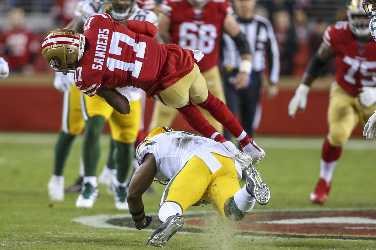 San Francisco 49ers wide receiver Emmanuel Sanders (17) hangs onto the football for a gain during the 2nd quarter against the Green Bay Packers defense at Levi's Stadium on Nov. 24. (Chris Victorio   Special to the S.F. Examiner)