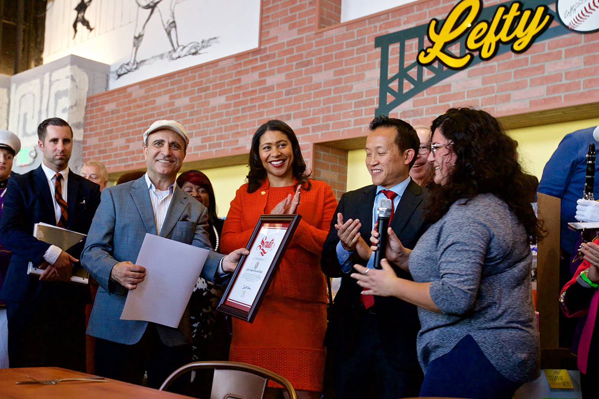 Nick Bovis, owner of Lefty O'Doul's Ballpark Buffet and Cafe, is seen here with Assemblymember David Chiu and Mayor London Breed at the grand opening for the Fisherman's Wharf restaurant on Tuesday, Nov. 20, 2018.