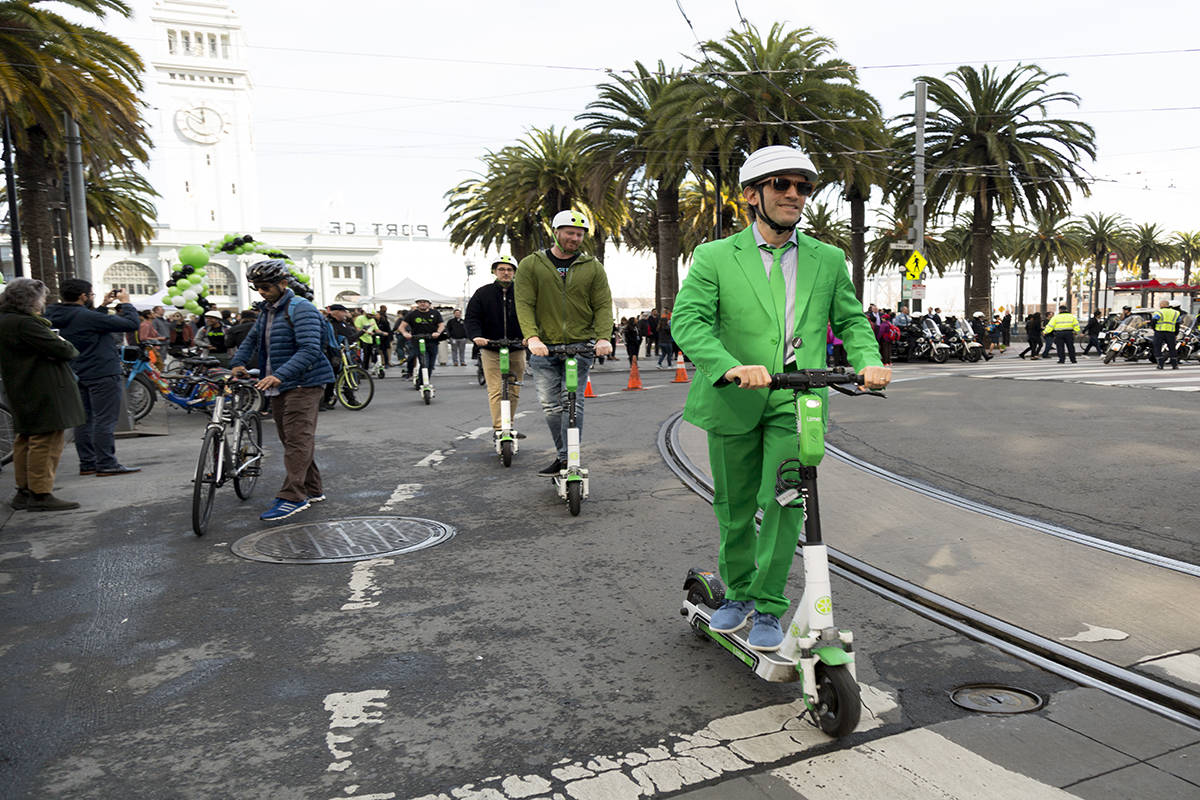 """David Richter, Chief Business Officer of Lime rides a Lime scooter at the Opening of Car-Free Market Street, """"A Better Market Street"""" and a ribbon cutting at Embarcadero and Market Street in San Francisco, Calif. Wednesday, Jan. 29, 2020. (Amanda Peterson/Special to S.F. Examiner)"""