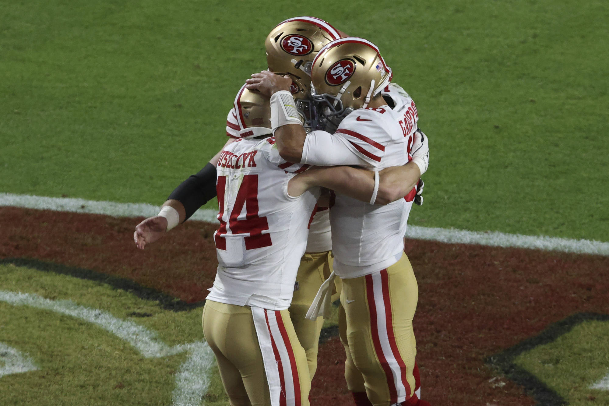 San Francisco 49ers full back Kyle Juszczyk (44) and San Francisco 49ers quarterback Jimmy Garoppolo (10) celebrate his touchdown score during Super Bowl LIV at Hard Rock Stadium on February 2, 2020 in Miami, Florida. (Chris Victorio | Special to the S.F. Examiner)