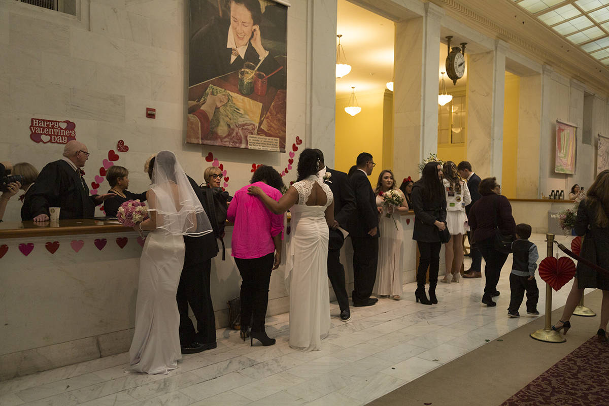 Love is in the air as couples say their vows at City Hall on Valentine's Day