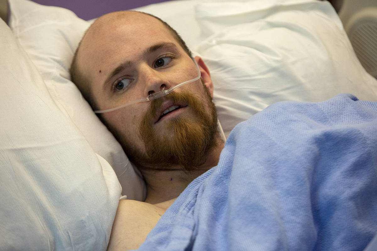Tad Crane, who was shot by an off-duty FBI agent on Feb. 9, spoke from his hospital bed at Zuckerberg San Francisco General Hospital on Tuesday, Feb. 18, 2020. (Kevin N. Hume/S.F. Examiner)