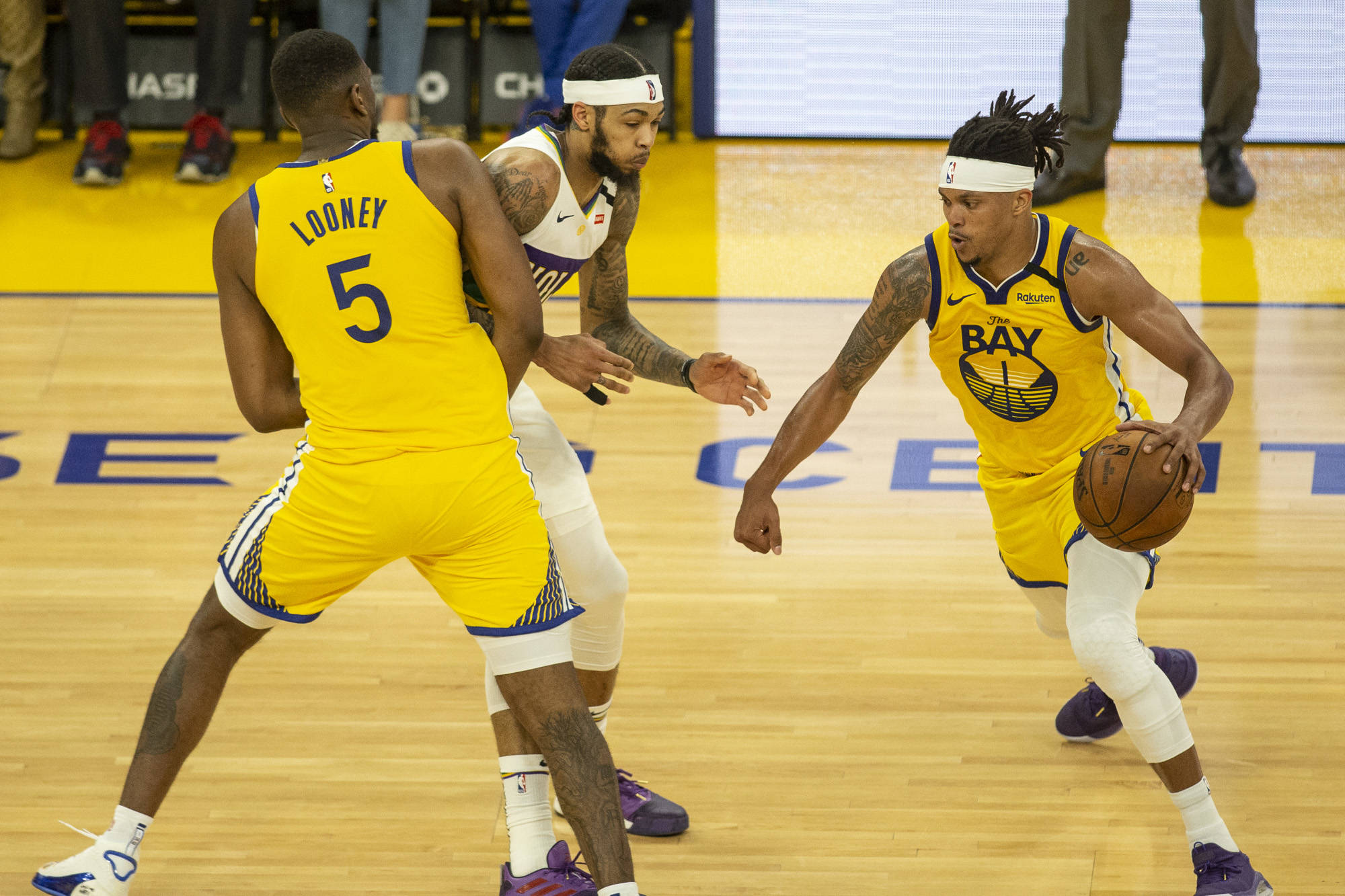 Golden State Warriors guard Damion Lee (1) gets a screen on New Orleans Pelicans forward Brandon Ingram (14) by Golden State Warriors center Kevon Looney (5) in the 2nd quarter at Chase Center in San Francisco, California on February 23, 2019. Photography by Chris Victorio | Special to the S.F. Examiner
