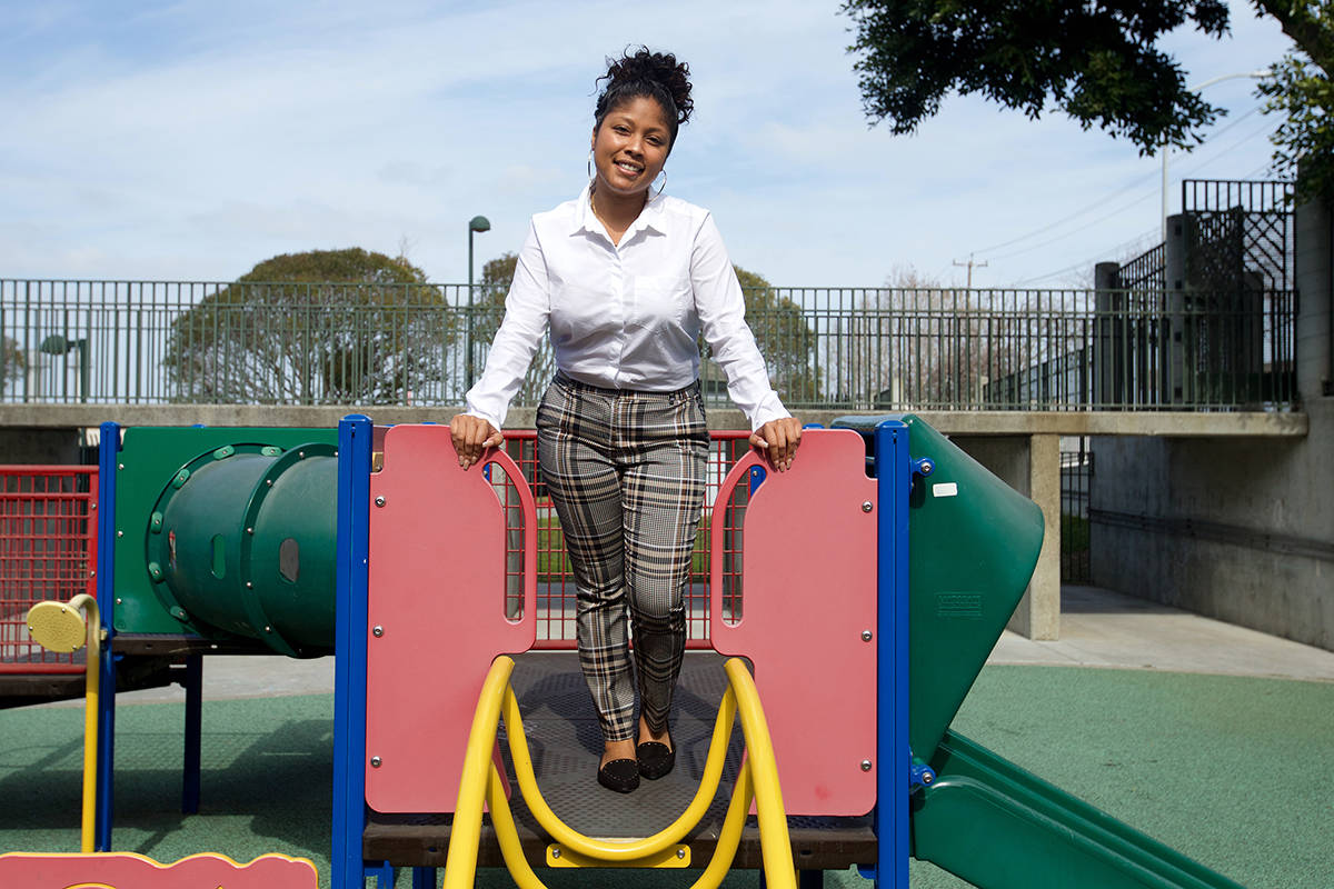 Briyanna Butler, a community partners liaison with the San Francisco Public Utilities Commission, stands atop the playground at the Head Start program, which Butler she attended as a youth. (Kevin N. Hume/S.F. Examiner)