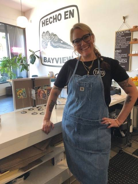"Kristin Houk in her restaurant Tato. ""Tato is my son's nickname and he (and his Mexican heritage and his father's family traditions) is the inspiration for this restaurant."" (Courtesy photo)"