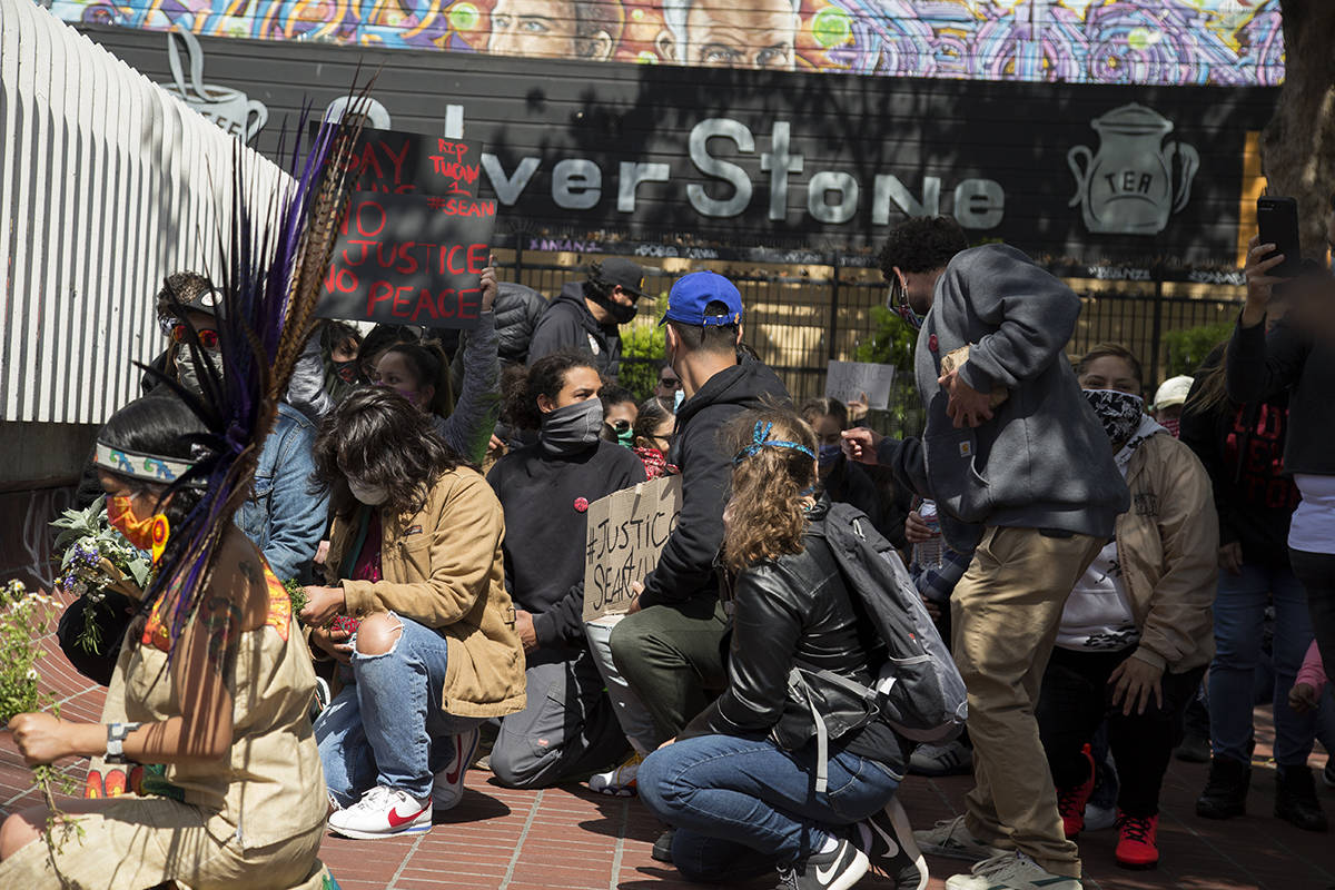 Friends and family kneel in honor of Sean Monterrosa, who was killed by a Vallejo police officer early Tuesday morning, at a memorial rally at the 24th Street Mission BART plaza on Friday, June 5, 2020. (Kevin N. Hume/S.F. Examiner)