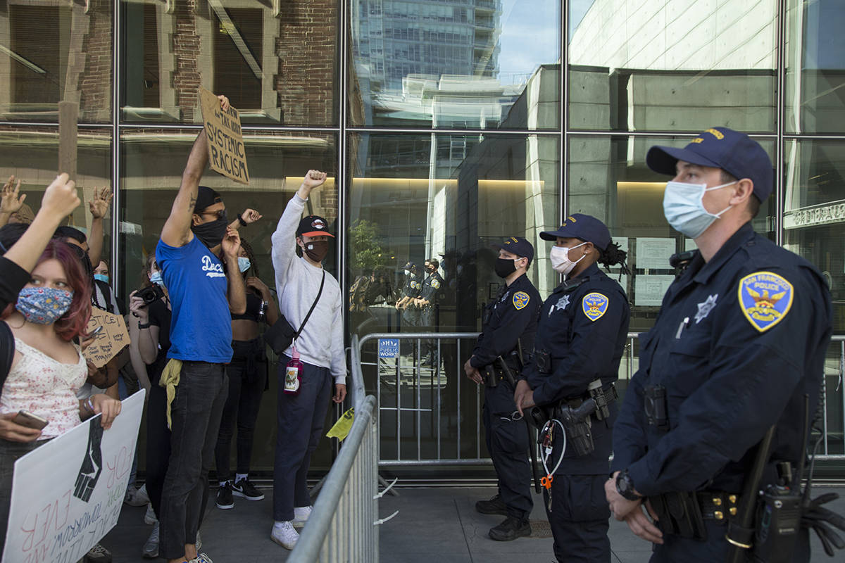 Students chant outside San Francisco Police headquarters along Third Street in Mission Bay during a Black Lives Matter march on Thursday, June 11, 2020. (Kevin N. Hume/S.F. Examiner)