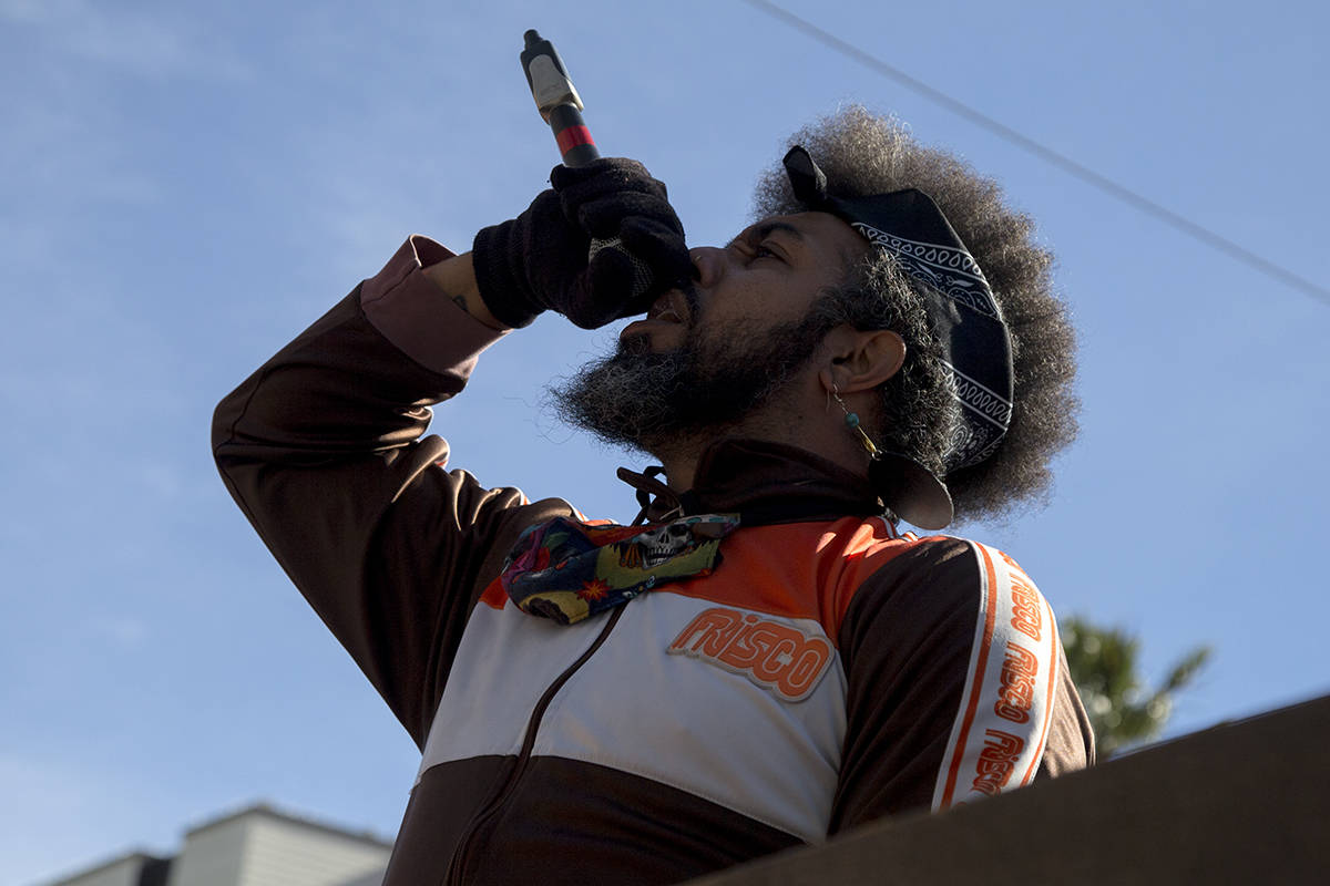 Poet Jeremy Vasquez performs for hundreds of students outside San Francisco Police headquarters during a Black Lives Matter march on Thursday, June 11, 2020. (Kevin N. Hume/S.F. Examiner)