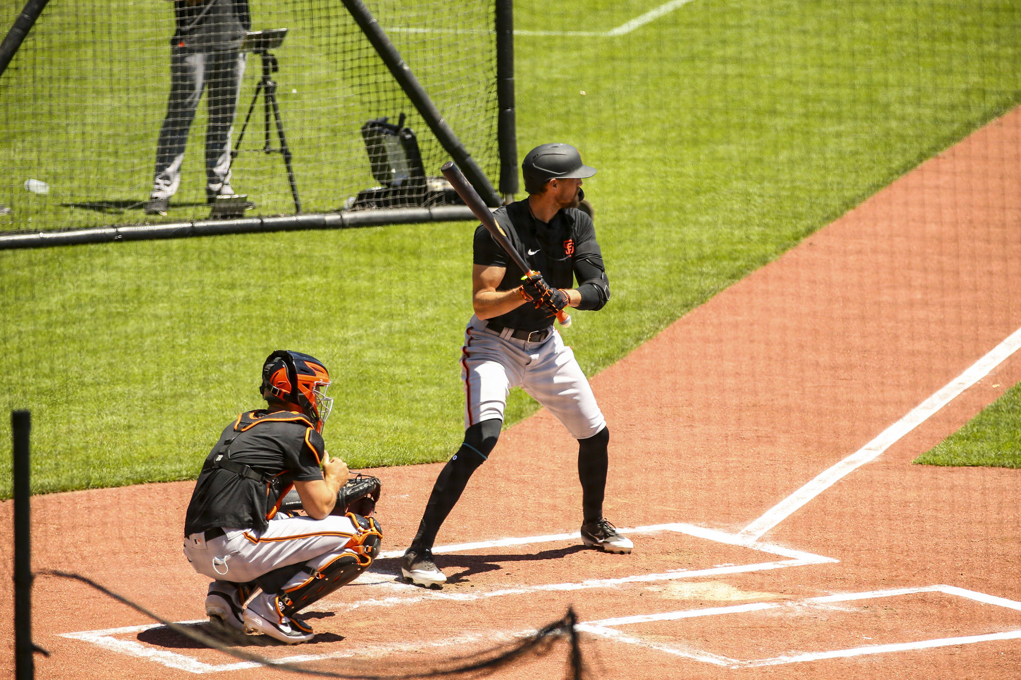 San Francisco Giants right fielder Hunter Pence (8) bats during live batting practice with Buster Posey (28) catching during the second day of summer workout at Oracle Park on July 4, 2020 in San Francisco, California. (Chris Victorio | Special to S.F. Examiner)