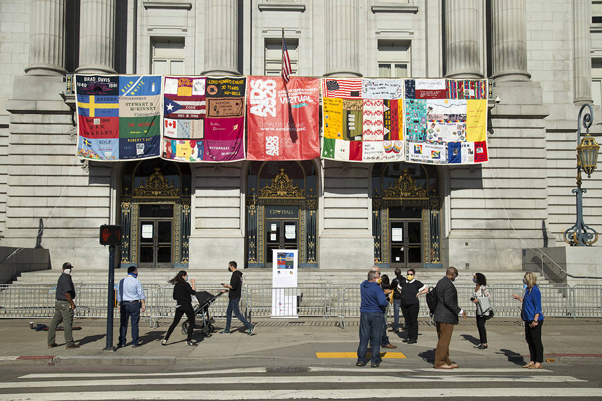 Sections of the AIDS Memorial Quilt are displayed outside the Mayor's balcony at City Hall on Monday, July 6, 2020. Sections of the quilt will be displayed in San Francisco and Oakland, official host cities for the 23rd annual AIDS International Conference which takes place this week. (Kevin N. Hume/S.F. Examiner)