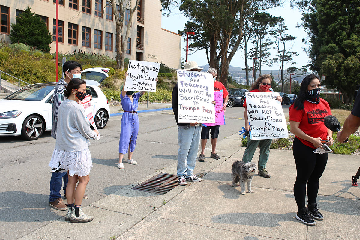 Protesters gather at CCSF before a car caravan protest to call on SF schools to stay closed due to Covid-19 on Wednesday, July 15, 2020. (Shandana Qazi/Special to S.F. Examiner)