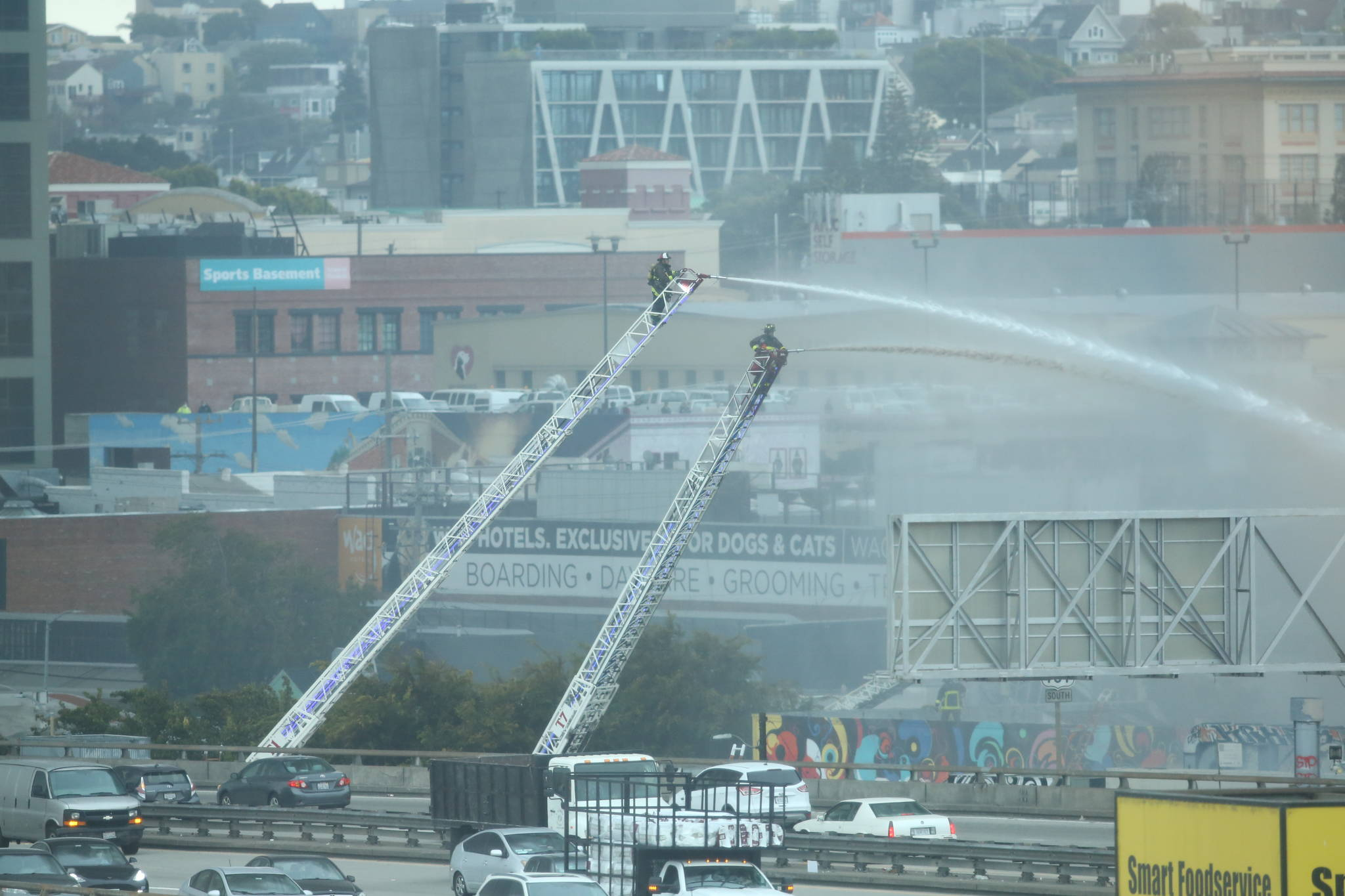 Firefighters put water on the flames of a five-alarm fire just south of the Central Freeway. (Chris Victorio/Special to the S.F. Examiner)