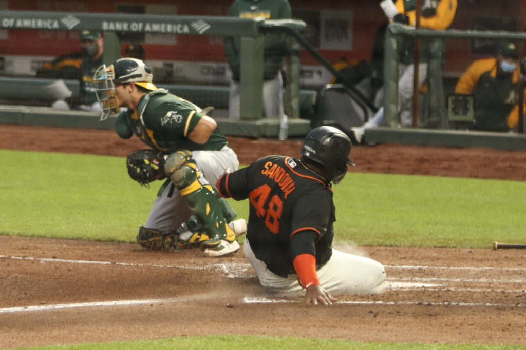 San Francisco Giants first baseman Pablo Sandoval (48) slides into home for the run scored against the Oakland Athletics at Oracle Park on July 21, 2020 in San Francisco , California. (Chris Victorio | Special to S.F. Examiner)
