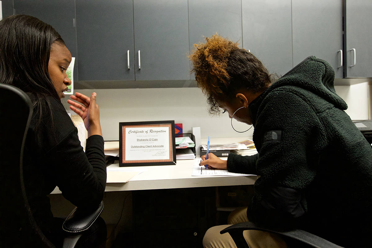 A rehousing coordinator at 3rd Street Youth Center and Clinic works with a client in the Bayview District. (Kevin N. Hume/S.F. Examiner)